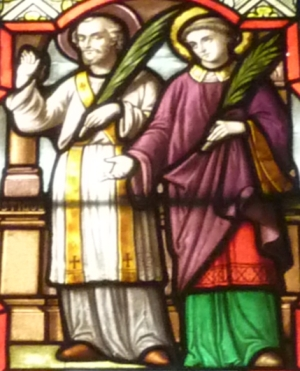 detail of a stained glass window depicting Saint Rusticus and Saint Eleuthere,