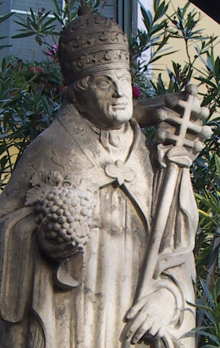 detail of a statue of Saint Urban of Langres by A Riedl, 1956; in Gumpoldskirchen, Lower Austria; photographed on 11 October 2009 by Anton-kurt; swiped from Wikimedia Commons