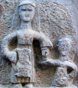 detail of a bas-relief sculpture of Saint Valeria of Milan and one of her sons taking water to her husband; taken by 1gagnepetit; swiped from Wikimedia Commons