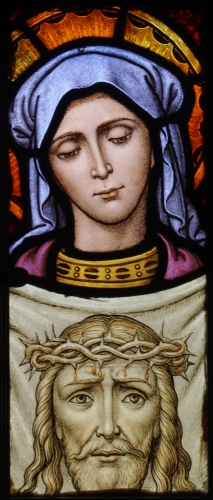 detail of a stained glass window of Saint Veronica; confessional of Saint Aloysius Church, Columbus, Ohio; swiped from Wikimedia Commons