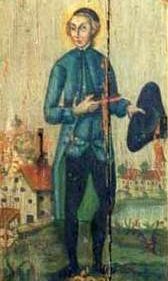 photograph of an 18th century painting of Saint Winnoc of Flanders on an old door sign in the Pforzner monastery mill