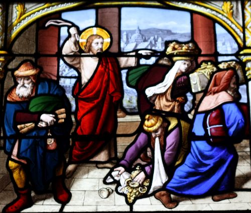 detail of a stained glass window depicting Jesus chasing vendors from the Temple; date and artist unknown; church of Saint-Aignan, Chartres, France; photographed on 22 January 2011 by Reinhardhauke; swiped from Wikimedia Commons