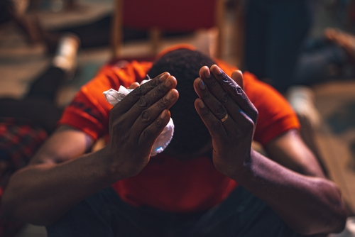 photograph of an unnamed Nigerian man in deep prayer; photographed on 23 April 2021 by Theindigochxid; swiped from Wikimedia Commons