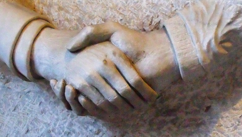 detail of a bas relief of hands of friendship, date and artist unknown; town hall in Duisburg, Germany; photographed on 12 April 2010 by Oceancetacen; swiped from Wikimedia Commons