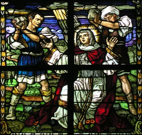 detail of a stained glass window depicting the martyrdom of a Christian; by the Binsfeld-Dornoff Company, Trier, Germany c.1920; in the church of Saint Clements in Trittenheim an der Mosel, Germany; photographed on 30 June 2006 by Norbert Schnitzler; swiped from Wikimedia Commons