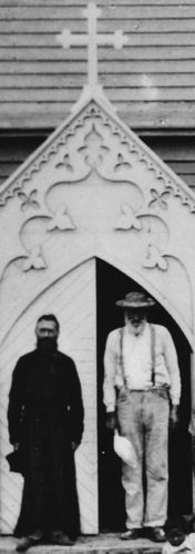 photograph of Father Damian and one of the colony residents standing at the front door of his church, c.1880