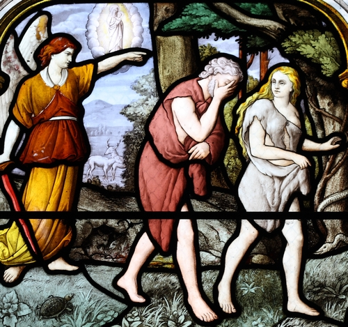 detail of a stained glass window of the expulsion from the Garden of Eden by Atelier Lorin, 1887 in the Church of Saint-Aignan in Chartres, France; it was photographed on 22 January 2011 by Reinhardhauke, and the image swiped from Wikimedia Commons