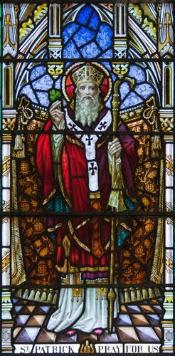 detail of a stained glass window of Saint Patrick, date and artist unknown. The window is in the 4th window of the north wall of the Church of Our Lady, Star of the Sea and Saint Patrick in Goleen, County Cork, Ireland. It was photographed on 10 September 2009 by Andreas F. Borchert, and the image was swiped from Wikimedia Commons